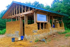 Mike and Andrea Reinhardt's cob home under construction in Missouri. Clay is from the property. Local Amish framed and put up the roof. In rainy environments it is a good idea to put up a roof while constructing the walls. Total cost about $15,000.