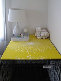 place a board covered with nice fabric over dog crate for instant added countertop in your space.