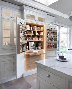 love the hidden coffee/tea station & marble counters