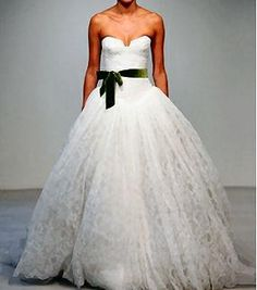 bridal gown- Irish lace with green velvet sash.i'd change the green...