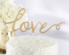 Gold Love Cake Topper, What sweeter way is there to commemorate your beautiful wedding day than with this lovely gold Love Cake Topper?