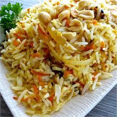 Carrot Rice - fragrant basmati rice sauteed with carrots, onions, fresh ginger, peanuts, and cilantro Indian Food Recipes, Asian Recipes, Vegetarian Recipes, Cooking Recipes, Ethnic Recipes, Vegetarian Dish, Asian Foods, Delicious Recipes, Cooking Tips