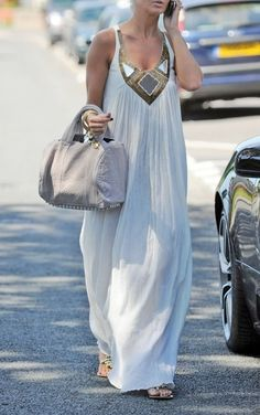 Long white dress .... looks so cool for those very hot African Summers