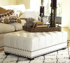 Remington Ottoman | Pottery Barn -- I love the shape, the tufting and the nail head detail -- fortunately there are over 75 fabric options.  White would survive in my house about two weeks and then it would gradually become a grey/beige that would not be attractive at all.