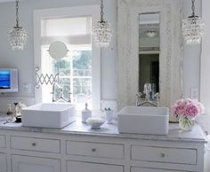 Love the glam pendants in lieu of sconces.  Love the mirrors too.  Rub a' Dub | Kim Myles