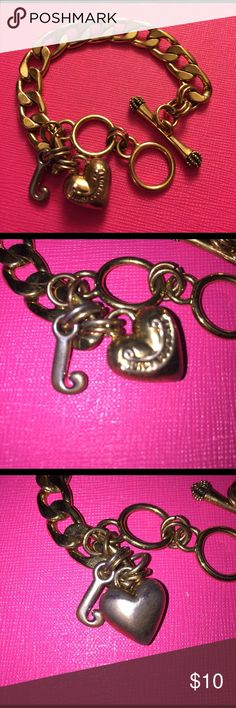 ✨Juicy Couture bracelet✨ Slightly tarnished (as pictured) but still in good condition Juicy Couture Jewelry Bracelets