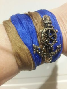 Parliament blue wristband with anchor detail