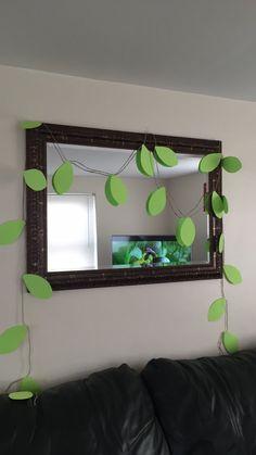 DIY jungle baby shower decorations: vines, green construction paper, jute twine.