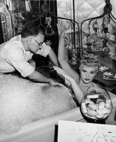 American actor Judy Holliday sits in a bathtub with her arms over her head while a propman positions foamy suds around her on the set of director George Cukor's film, 'It Should Happen to You'. (Photo by Hulton Archive/Getty Images) Bette Davis, Judy Holliday, Broadway, Caption Contest, Movie Memes, Columbia Pictures, Film Director, Old Hollywood, Hollywood Actresses