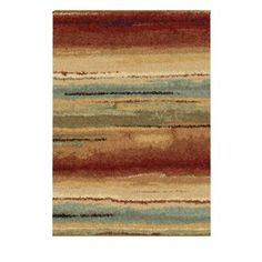 With a shag-length tuft and an abstract design, the Dusk to Dawn area rug offers…
