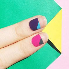No math skills required for this cool geometrical manicure—just tape, a striping brush and a handful of contrasting polishes.