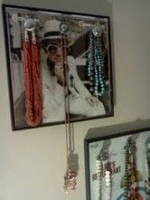 3 individually framed vinyl records on wall for necklaces