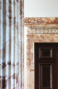 Doorcase with pulvinated frieze in the Stone Hall at Holkham Hall, Norfolk. photography by Rubens1577 (flickr)