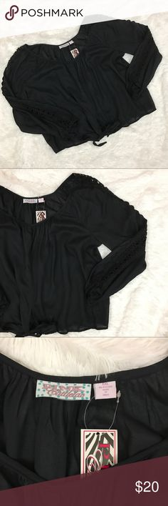 """Pink Cattlelac Boho black tie front top, XXL 236 This black NWT Pink Cattlelac brand Blouse has a tie fromtand Crochet I set detail down the sleeves.  It is in excellent condition with original tags and no flaws.  It is a size XXL and measures 28"""" flat across the bust and is 25.5"""" long. Very lightweight airy fabric. pink cattlelac Tops Blouses"""