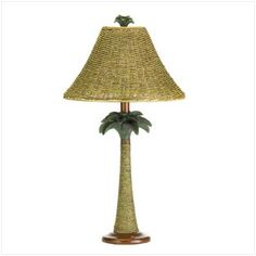 "Bring breezy Bahama style to any room with this clever column lamp! Real rattan rope adds natural appeal to a vintage-look palm tree base and nubby open-weave shade. Polyresin with rattan rope shade. UL recognized. Uses 40-watt bulb (not included). 13 1/2"" diameter x 25 1/2"" high."