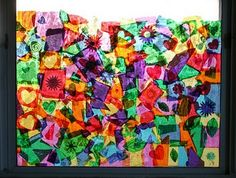 Tissue paper & glue window collage.  I need this on my bathroom window...always wanted a stained glass window, but this is more in my budget right now!!