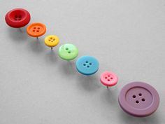 Make your bulletin boards prettier by glueing buttons to push pins.