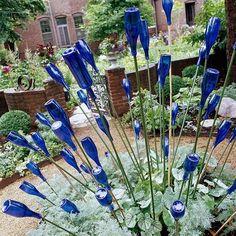 wine bottles for flower bed edging | bottle tree | DIY