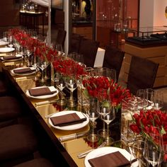 modern table setting for wedding with brown napkins and rows of flowers