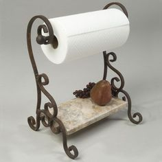 Bring old world charm to your kitchens decor with his wonderfully unique standing wrought iron paper towel holder.: