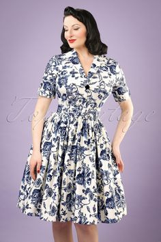 This 50s Janet Toile Floral Shirt Dress is one to fall in love with!  A beautiful shirt dress which isn't only suited for a retro look in the evening, this stunning swing style is also very suited for a day at the office! Her elegant V-neckline, playful collar, short sleeves and belt which will give you a stunning feminine silhouette, will make you feel like a real woman. Made from a sturdy yet breezy white cotton blend with a light stretch which is covered with countless dark b...