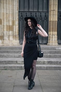 Fashion blogger Stephanie of FAIIINT wearing Catarzi wide brim fedora, Allsaints shirt, FAIIINT draped jersey asymmetric skirt, Ash Poker lace up boots, Hvnter Gvtherer Lacustrine necklace & rings. All black everything dark style goth outfit.