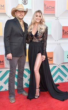 "Jason Aldean & Brittany Kerr from ACM Awards 2016 Red Carpet Arrivals  Before performing his new single ""Lights Come On,"" the country star poses with his wife."