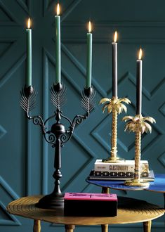 "The black peacock feather and gold palm tree candle holders. Matthew Williamson launches a capsule collection of homeware for CB2 in the USA. It includes 33 pieces including lighting, accessories, rugs, pillows and furniture. ""Everything I've designed is intended not to match perfectly but to sit together in harmony, to add flair and personality to any room."""