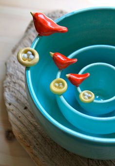 Custom-Made Pottery Bird & Nest Nesting Bowls - at $160, I might be afraid to actually use them regularly. But they're SO lovely!!