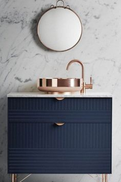 Marble and copper look fantastic together, especially when paired with muted blue-gray walls. Don't always default to white marble.