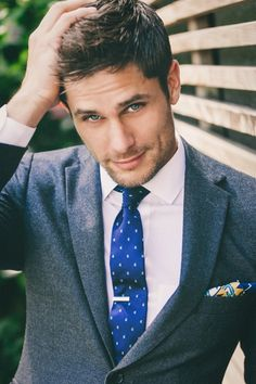 Like the suit, the tie, the tie bar, the pocket square, and the haircut... so yes all around.