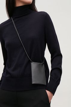 This phone pouch is made from smooth leather with a tubular leather strap. A multi-functional design, it has three credit card slots on one side and a back opening for a mobile phone on the other. Tote Bags, Minimalist Bag, Backpack Pattern, Tablet, Casual Bags, Purses And Handbags, Leather Wallet, Bag Accessories, Womens Fashion
