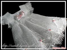 http://asreceitasdecroche.blogspot.se/2012/10/vestidinho-de-croche-branco-com-esquema.html