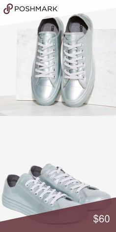 """Converse women's size 8 Metallic shoes This sneaker's the OG–and it just sprang back. The All Star Sneaker is made in metallic silver rubber and features a lace-up front, textured outsole, gray laces, and logo at tongue.  *Rubber  *Shoe height: 3.25""""/8.3cm  *Platform height: 1.25""""/3.2cm  *Imported Converse Shoes Athletic Shoes"""