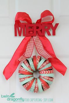 Holiday Mason Jar Lid Wreath - you could change the ribbon and the top part out and do this year round for so many occasions or color schemes.