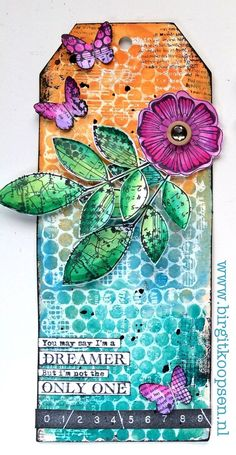 Very colourful tag by Birgit Koopsen for Carabelle Studio