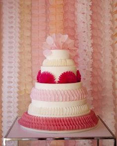 The CAKE was created by Cheryl Kleinman - a white fondant cake then covered in pieces of tissue paper bells, cut into different shapes for each tier.