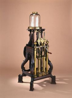 An air pump and condenser from 1761, made from mahogany, brass, glass, leather and iron