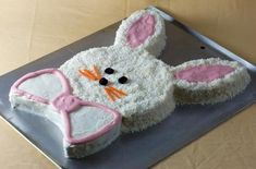 This #Easter bunny cake is an easy and festive dessert. All you need is a box of white cake mix, a container of frosting, #coconut, and some colorful candy.