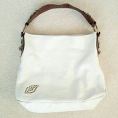 Betsey Johnson Cream Leather Hobo Handbag Purse This gorgeous Betsey Johnson handbag features cream leather with a brown leather strap. It has gorgeous embroidery and chain accents. Leather is in good condition overall with some wear on bottom. Interior pocket has come undone on the side (see last photo). This is a very unique bag that really stands out! Betsey Johnson Bags Hobos