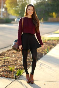 black cotton knit leggings, black high waisted skirt, dark red long sleeve cropped belly sweater, and heeled ankle boots.