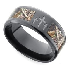Beveled Camo Inlay Men's Ring with Cross Design in Zirconium. Three crosses adorn the top of this 9 mm zirconium band with a Realtree camouflage inlay and beveled edges for a smooth finish. Proudly made in the USA and comfort fit. https://www.brilliance.com/wedding-rings/beveled-camo-inlay-cross-design-mens-band-9-mm-zirconium
