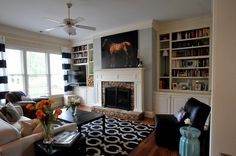 a horse. of course! - the*shooting*allens  navy blue, living room, horse, striped curtains, garden stool, bookshelves