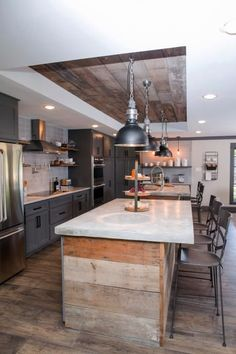 The newly expanded kitchen also comes with new stainless appliances and vent hood, recessed lighting, accent pendants, and plenty of storage and open shelving.