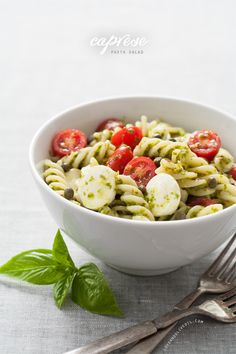 Caprese Pasta Salad: tangy white-balsamic and basil dressing, cherry tomatoes, mozzarella, and capers.