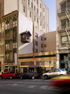 """""""Manifest Destiny! is a temporary rustic cabin occupying one of the last remaining unclaimed spaces of downtown San Francisco—above and between other properties. The cabin is affixed to the side of the Hotel des Arts, floating above the restaurant Le Central like an anomalous outgrowth of the contemporary streetscape."""""""