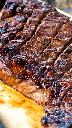 Grilled London Broil Recipe ~ Says: This Grilled London Broil is juicy and flavorful and cooks in just a matter of minutes. Making shallow cuts on each side of the meat helps it cook up just right and lets the flavor of the marinade really get into the meat.