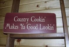 Country Cookin Makes Ya Good Lookin Distressed Country Sign. $18.00, via Etsy.