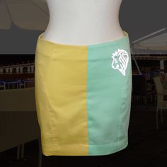 Yellow and green mini skirt with fashionable reflective artwork