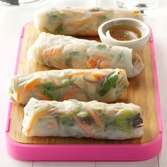 Pork & Vegetable Spring Rolls Recipe -I thought rice paper wrappers would be a quick, fun way to put salad ingredients into a hand-held snack or meal. I also make this with shrimp or add in cranberries. Go ahead, experiment! —Marla Strader, Ozark, Missouri